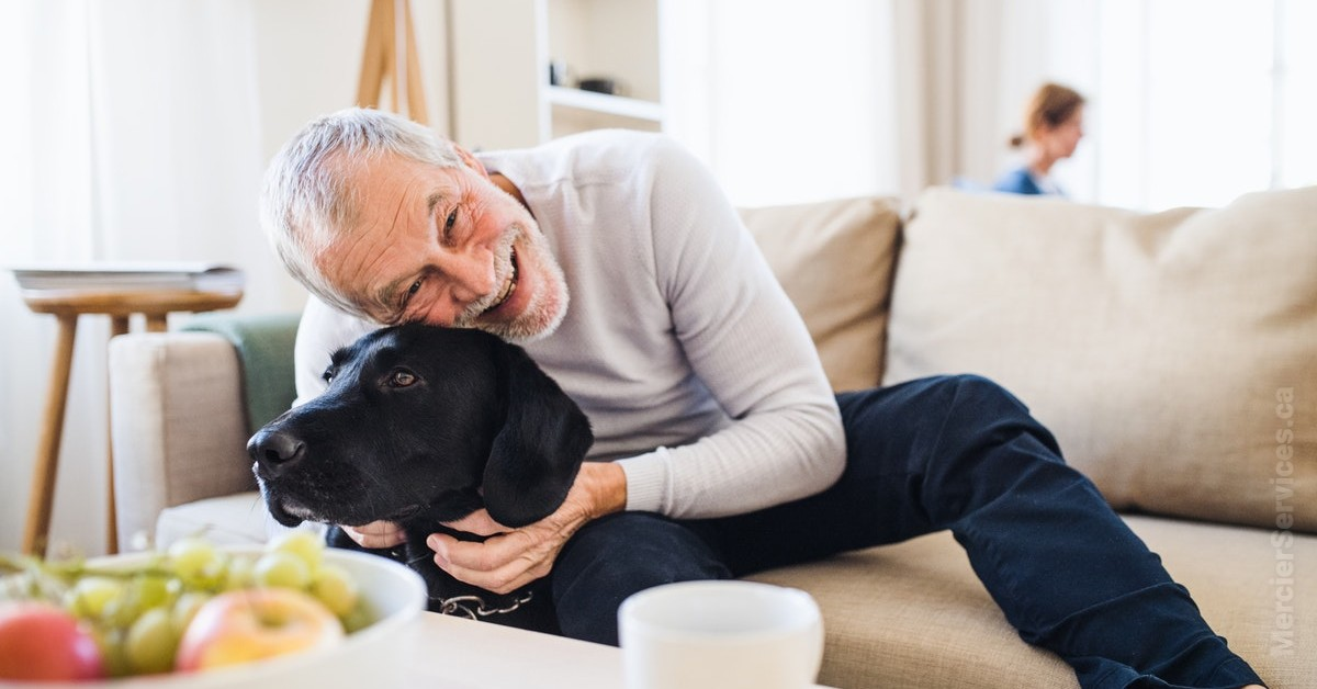 retired man hugging dog